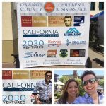 Josh Bois and his logo 2030 Ventures on the press wall of OC Childrens Business Fair